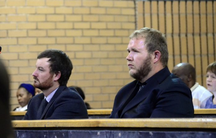 Farm workers Pieter Doorewaard and Phillip Schutte at the North West High Court during the verdict on the murder Matlhomola Mosweu