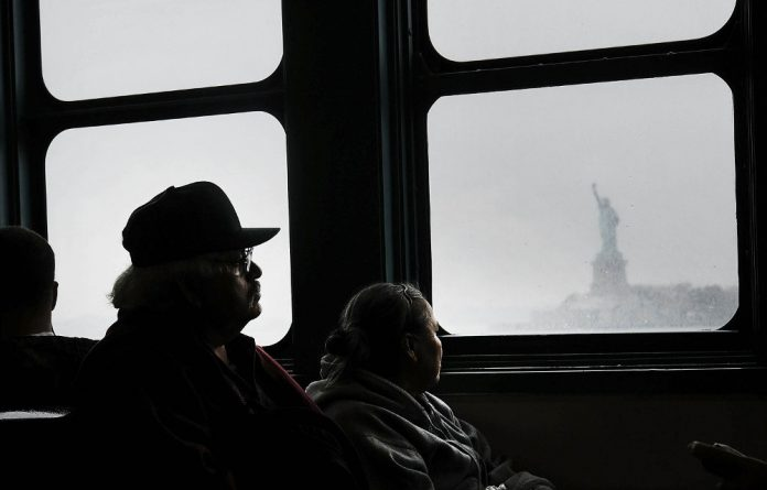 Some American citizens are now contemplating the Statue of Liberty