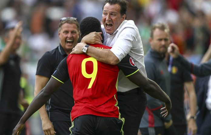Romelu Lukaku celebrates a goal with manager Marc Wilmots during Belgium's game against Ireland in Bordeaux on June 18.