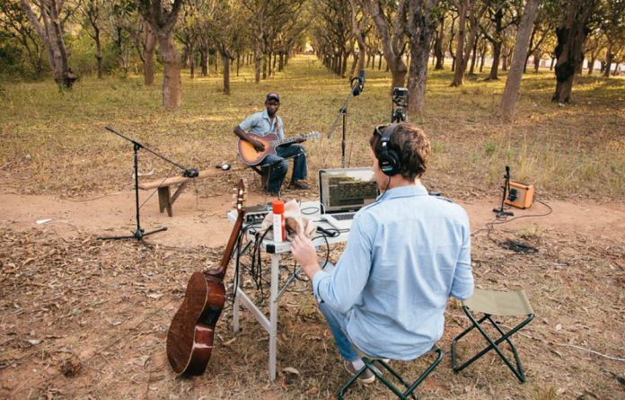 Band in the bush: Freshlyground members Simon Attwell and Julio Sigauque headed for northern Mozambique with their Wired for Sound project where they recorded musicians in a studio set up in a 4x4.