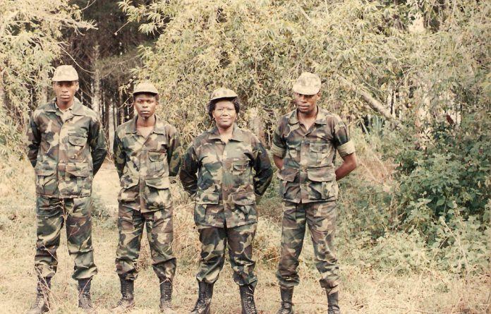 Good shot: Nomvo Booi is seen here with comrades at the Bamagamoyo camp at Mothopheng Military College in Tanzania