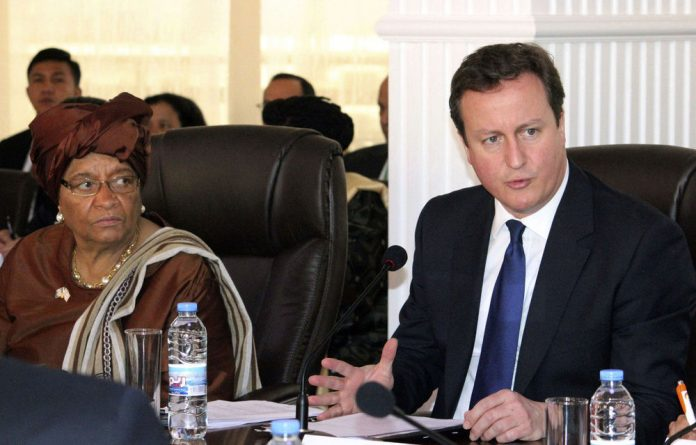 Britain's Prime Minister David Cameron and Liberia's President Ellen Johnson Sirleaf co-chair a meeting of the United Nations High Level Panel in Monrovia