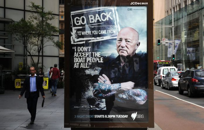 A poster promotes the documentary Go Back to Where You Came From