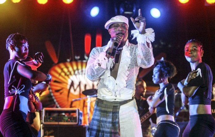 He will be missed: Koffi Olomide and members of the Quartier Latin group.