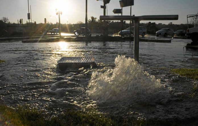 A burst water main illustrates the power that could be tapped from a city's system.