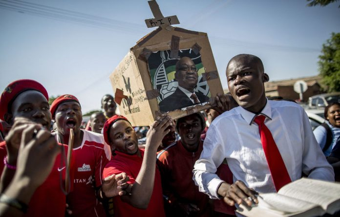 EFF supporters parade a mock coffin bearing a picture of President Jacob Zuma during the final electoral campaign rally in Atteridgeville.