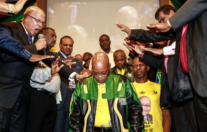 Jacob Zuma is blessed by local pastors and priests during a campaign event at the Interfellowship Church in Durban.