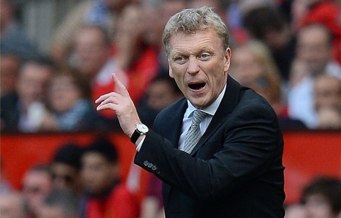 David Moyes as a manager at Manchester United between 2013 and 2014
