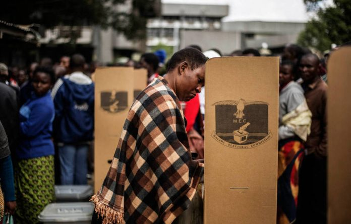 Decisions: A woman in Blantyre votes in Malawi's general elections last May