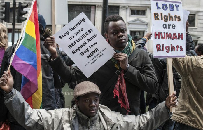 Nigerian LGBTIs and supporters in London protest outside the Nigerian High Commission against Same Sex Marriage Prohibition Act in 2014.