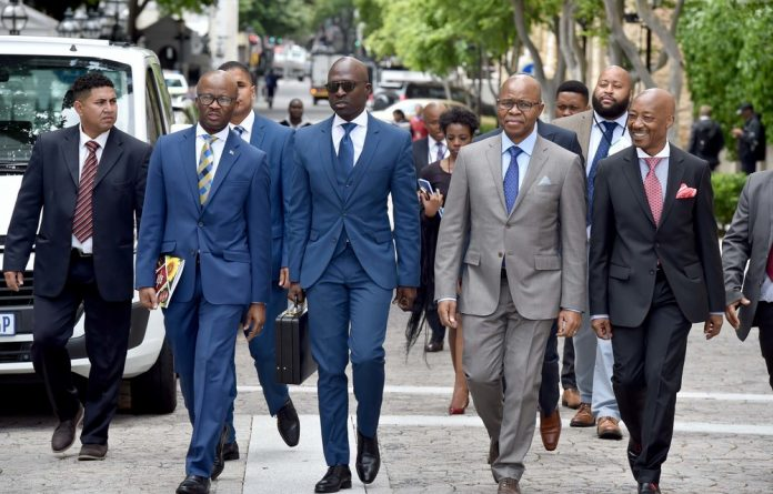 Implicated: Finance Minister Malusi Gigaba's impeccably tailored suit could not conceal the narrative of a rotten state