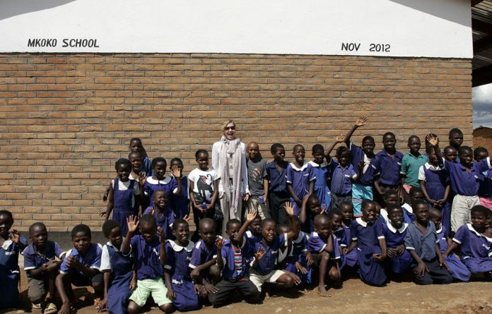Madonna with school children at Mkoko Primary School in the region of Kasungu in central Malawi.