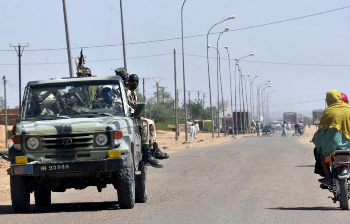 A file image of Niger army soldiers patrolling outside Agadez in northern Niger.