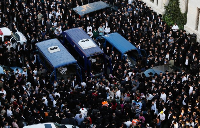 Ultraorthodox Jews mourn the men who were killed by two Palestinians at a synagogue in Jerusalem this week.