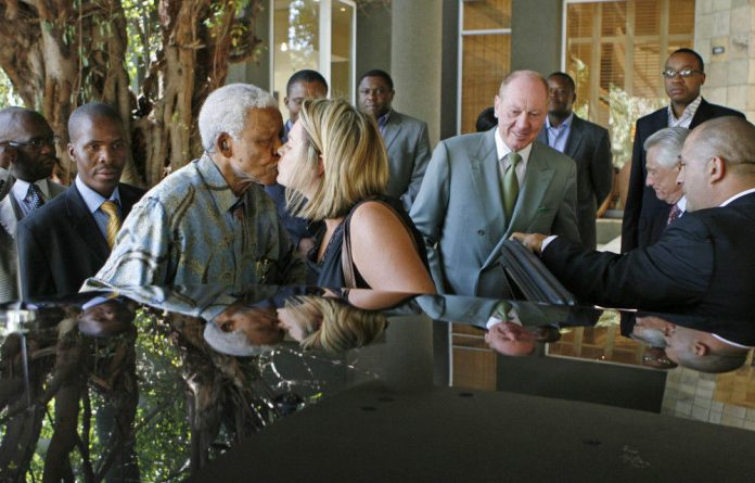 Nelson Mandela affectionately kisses his personal assistant Zelda la Grange at the Saxon Hotel in Johannesburg on March 20 2007.