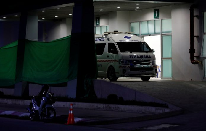 An ambulance parks at the entrance of Chiang Rai Prachanukroh hospital in the northern province of Chiang Rai