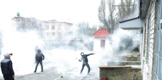 Pro-Russia activists throw stones as they storm the regional police building in the eastern Ukrainian city of Horlivka.