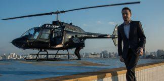 Brazilian businessperson Gustavo Boyle prepares to board a helicopter in Sao Paulo