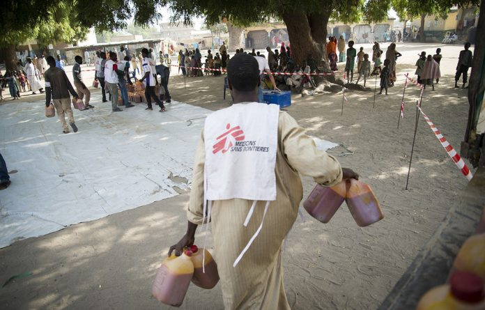 MSF teams distribute food to displaced families living in formal and informal camps in Maiduguri