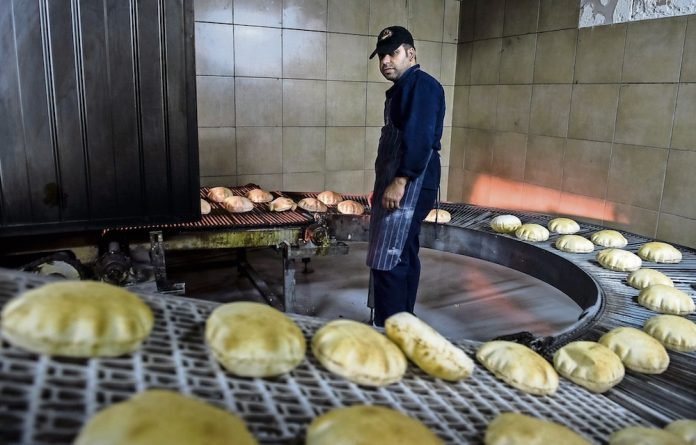 Pita breads on the production line at Damas Bakery in Ormonde.