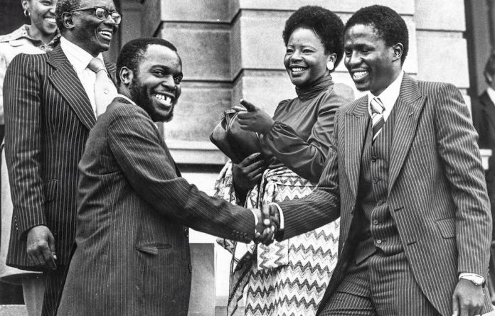 Ernest Dikgang Moseneke being congratulated by his friends and family after being admitted as an attorney
