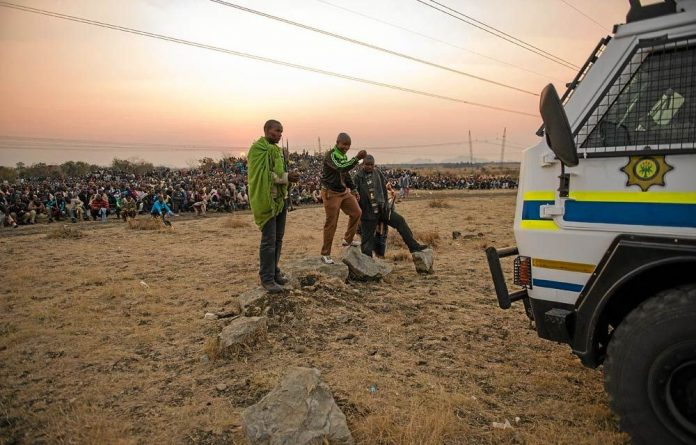Lonmin miners gather at Marikana on August 15 2012