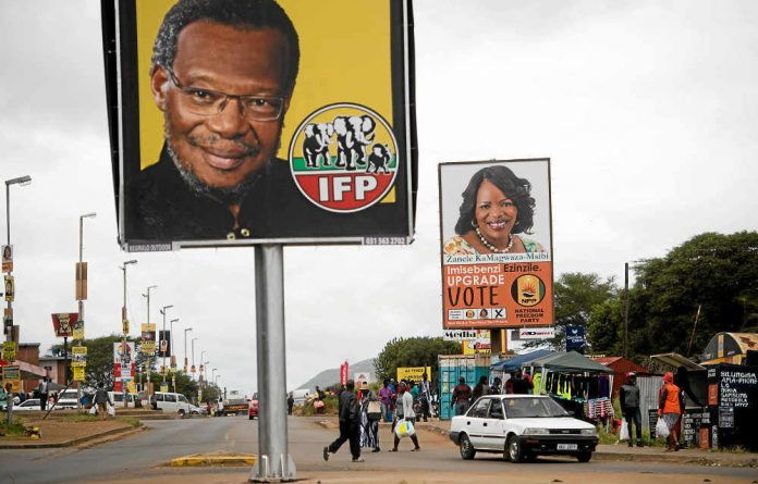 Jostling for attention: IFP and NFP billboards compete for space.