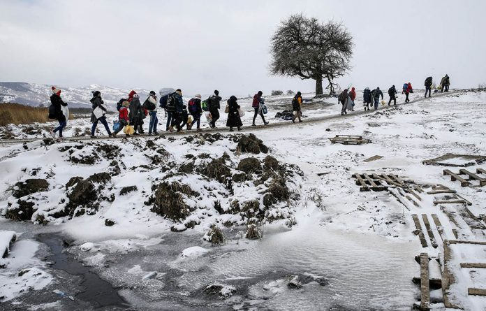 Migrants on the move in Serbia are among the world's 125-million left destitute by war and natural disasters.