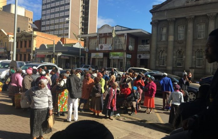A group of mostly pensioners waited for hours outside the post office in Langalibalele Street