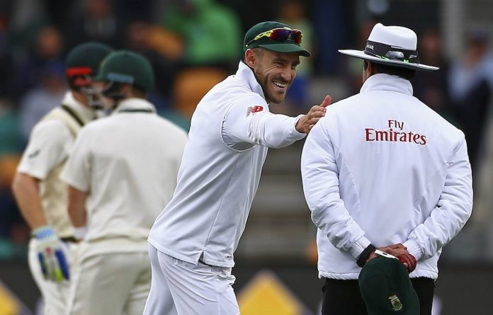 A sweet guy: Faf du Plessis has a smile and a pat for umpire Aleem Dar.