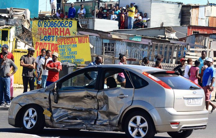 A car smashed into by a security vehicle during protests in Khayelitsha.