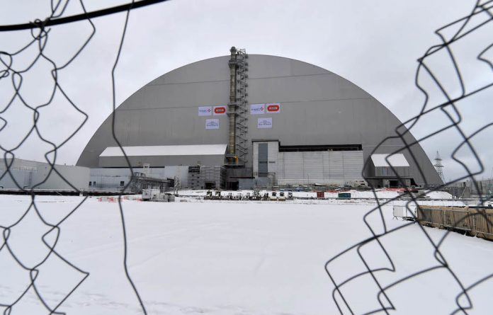 Chernobyl's New Safe Confinement covering the destroyed 4th block of Chernobyl Nuclear power plant during the inauguration ceremony.