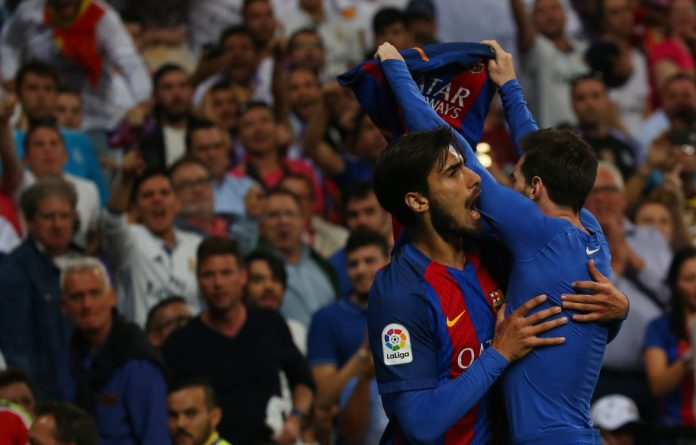 Lionel Messi celebrates after winning it for Barcelona at the death.