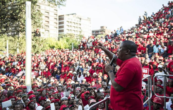 In this file photo Julius Malema drew a crowd of supporters at the Constitutional Court. On Thursday he filed papers asking the court to rule that Parliament had a duty to hold Zuma to account.