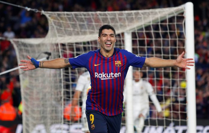 Barcelona's Luis Suarez celebrates scoring their fourth goal and completing his hat-trick