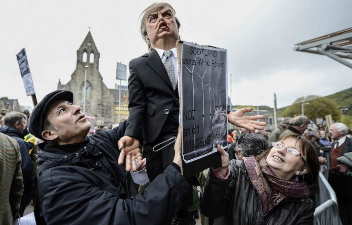 Then and now: Demonstrators outside the Scottish Parliament in 2012 after Donald Trump spoke of his concerns over a proposed wind farm. Photo: Jeff J Mitchell/Getty Images