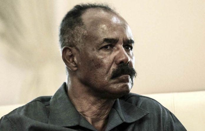 The tyrant and his prisoner: Eritrea's president Isaias Afwerki has kept journalist Seyoum Tsehaye in jail since September 2001.