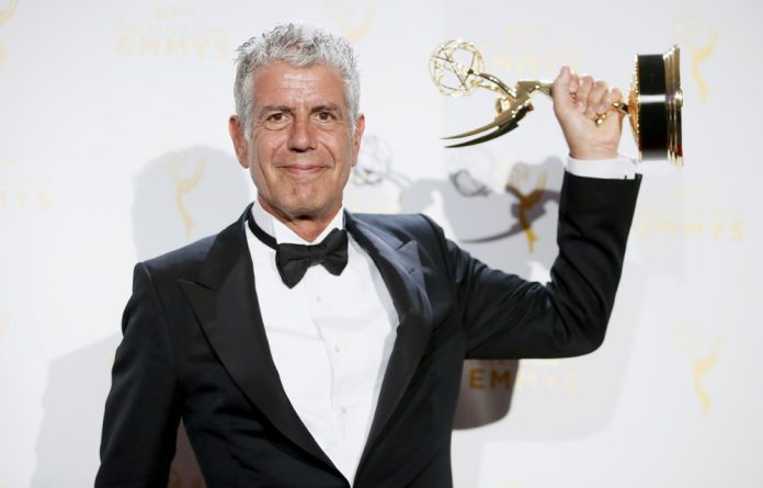 Anthony Bourdain poses with the outstanding informational series or special award for