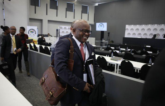 Former Sars commissioner Tom Moyane speaks on his mobile phone inside the high court in Pretoria on December 11 2018 in Pretoria
