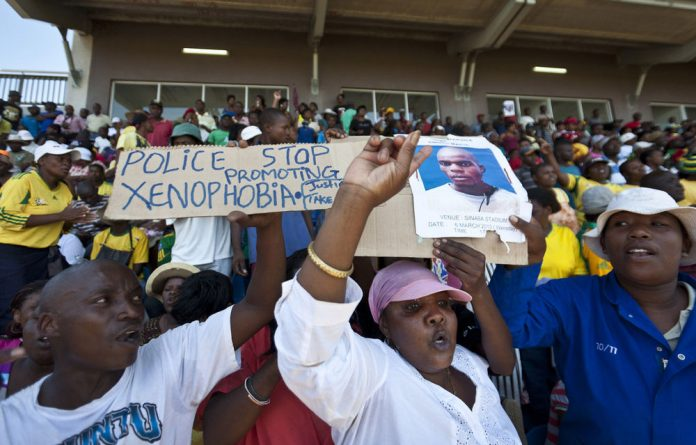 Mido Macia mourners gathered at a sports stadium in Daveyton for the taxi driver's memorial service.