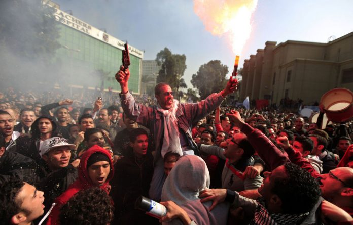Al-Ahly club members celebrate a court verdict that returned 21 death penalties in last year's soccer violence