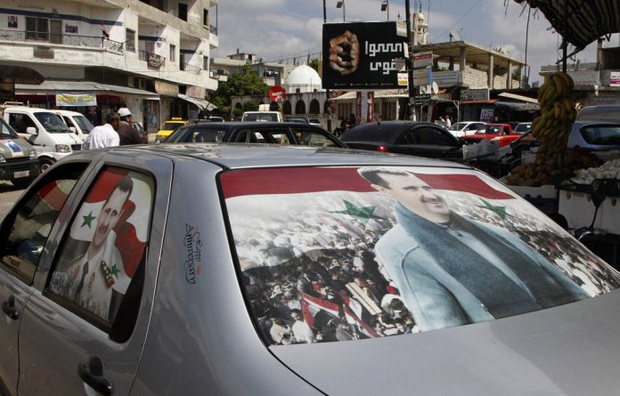 Political analysts say the Syrian 'blood elections' are President Bashar al-Assad's way of intimidating the opposition and showing that he is still in charge.