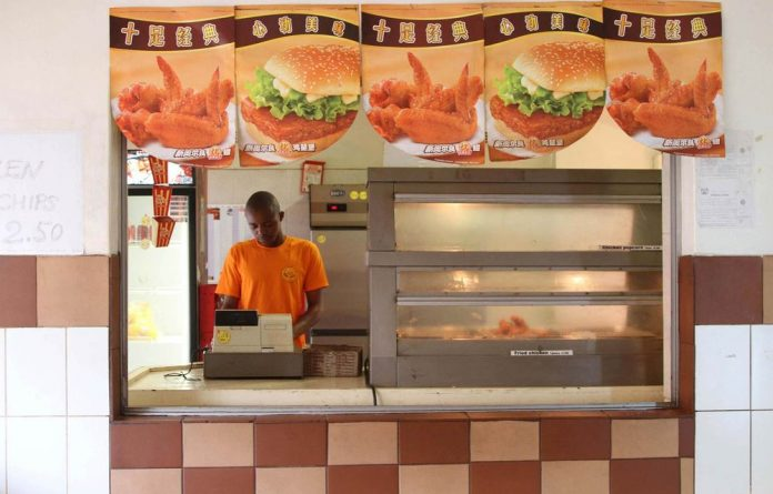 Harare's little Shanghai: A boom in Chinese restaurants indicates China's growth in Zimbabwe.