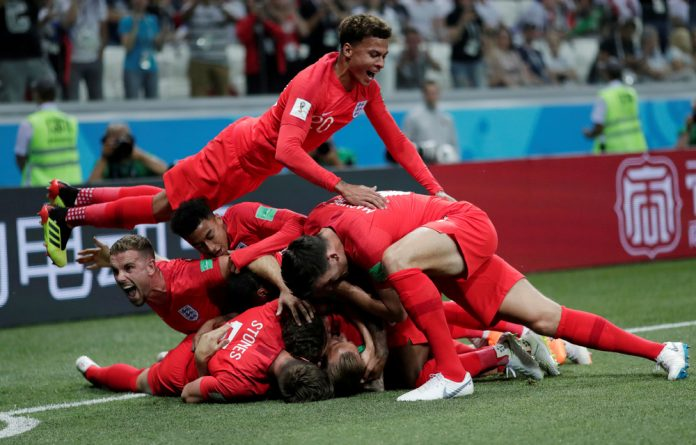 England's Harry Kane celebrates with team mates after scoring their first goal