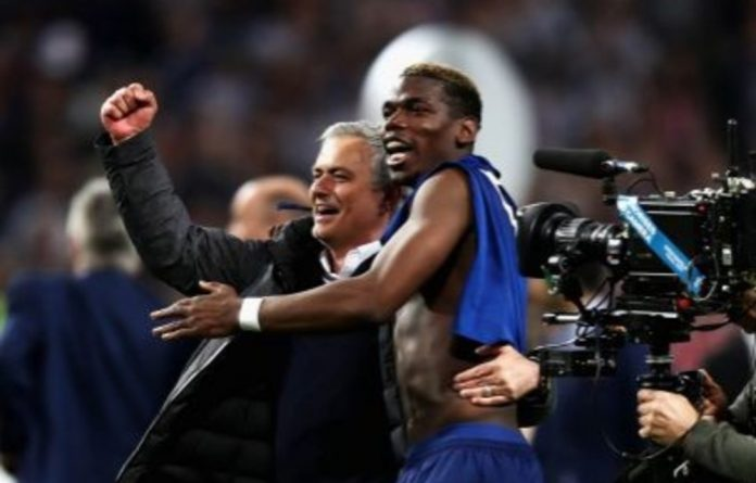José Mourinho and Paul Pogba in happier times after winning the Europa League.