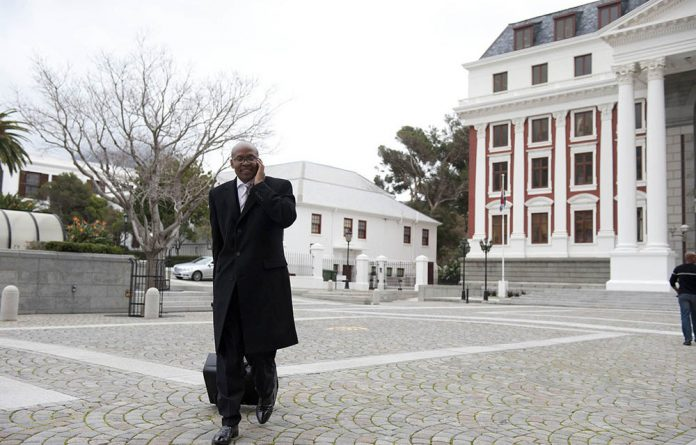 Jimmy Manyi outside Parliament in Cape Town in 2011.