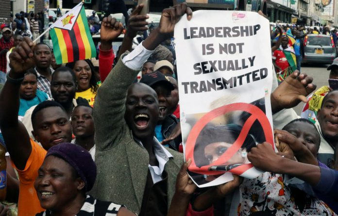Protesters calling for Zimbabwean President Robert Mugabe to step down take to the streets in Harare