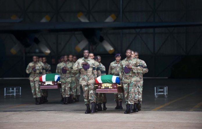 The bodies of two soldiers are handed over to family members during a ceremony at Air Force Base Waterkloof near Pretoria on March 28.