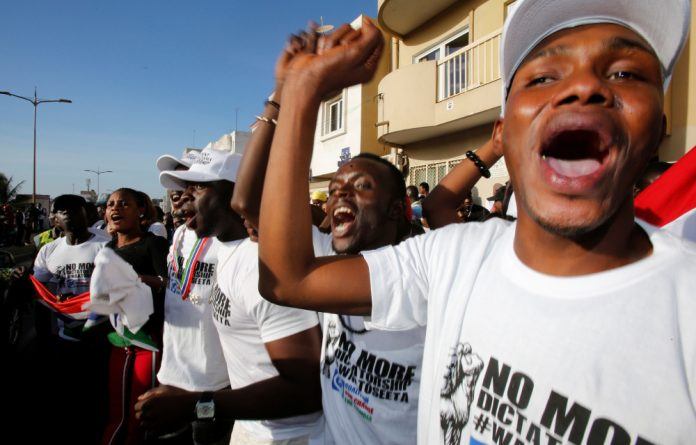 Supporters of president-elect Adama Barrow celebrate his inauguration at Gambia's embassy in Dakar