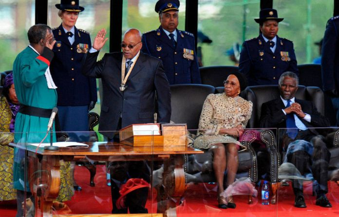 Jacob Zuma is sworn in as president by then chief justice Pius Langa in 2009.